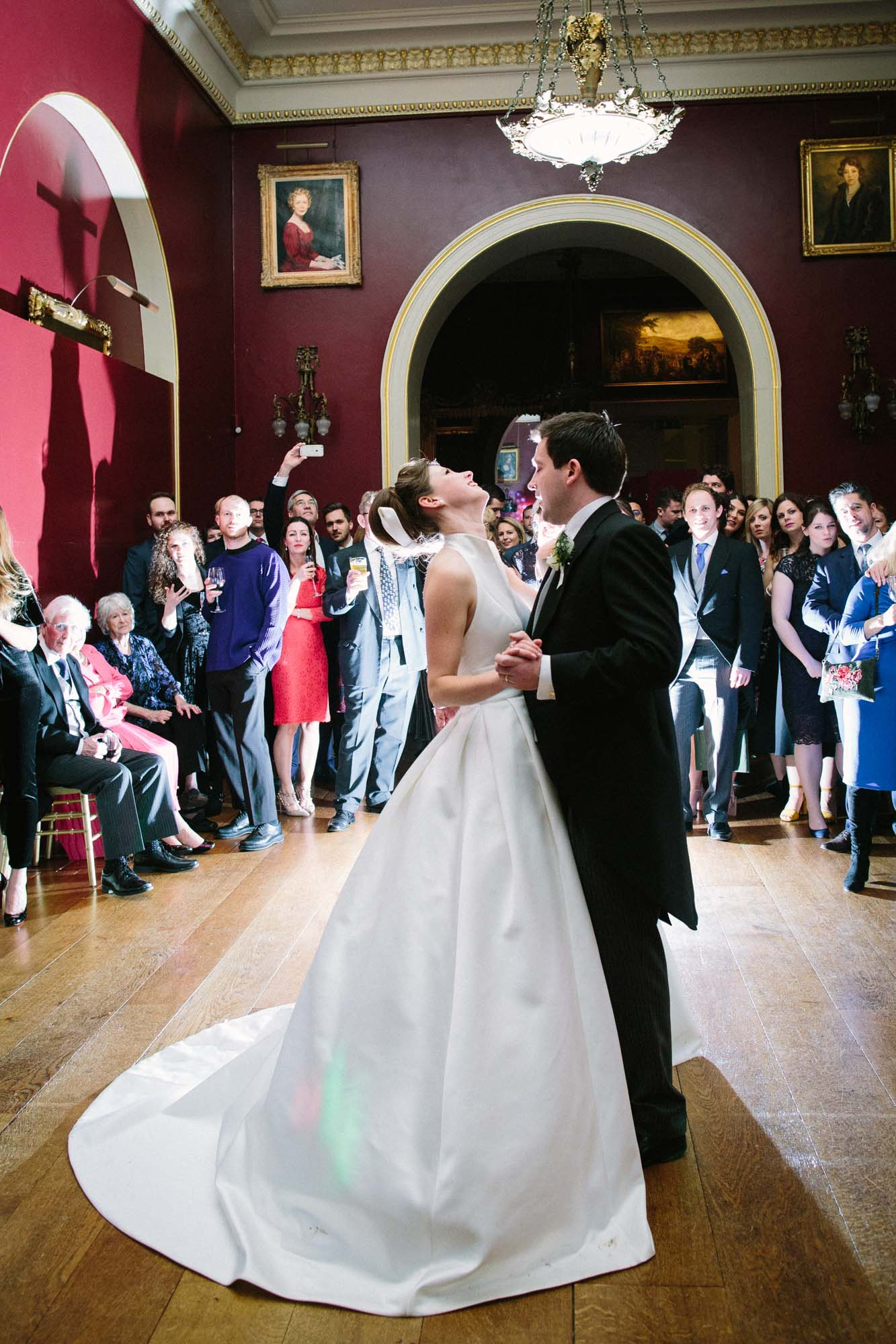 Bride and groom performing their first dance at Goodwood House