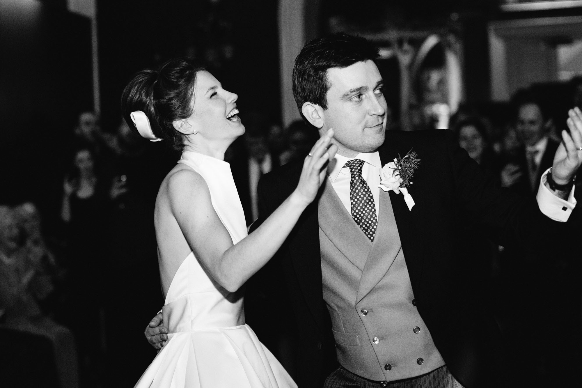 Bride and groom laughing on the dance floor at Goodwood House