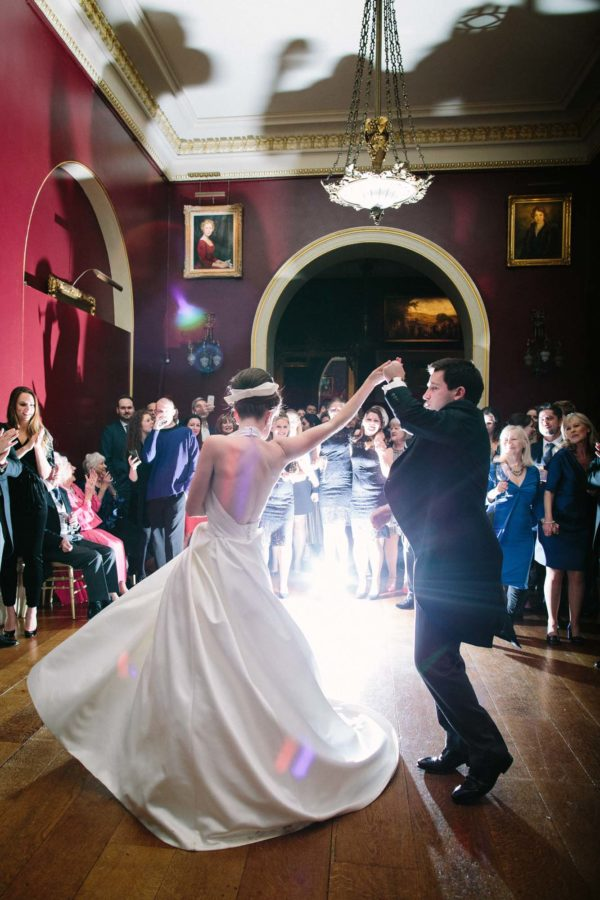 Bride and groom dancing at Goodwood House wedding