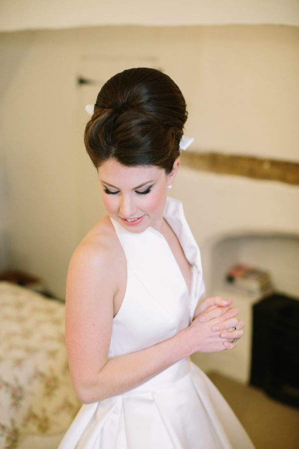 Elegant bridal portrait of bride in Jesus Peiro wedding dress on morning of Goodwood House wedding