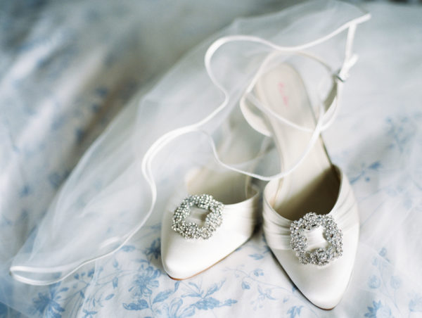 Bridal shoes with diamanté detail and white veil