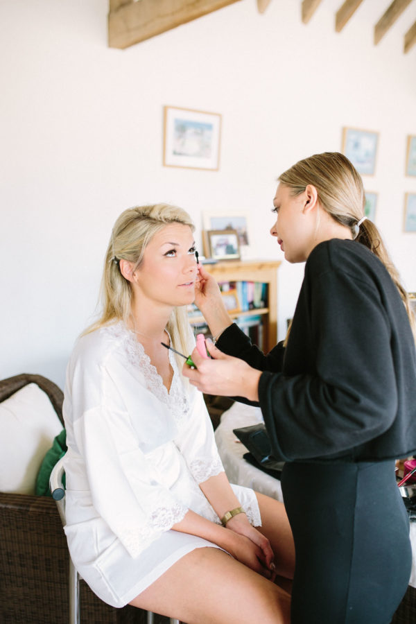 Bride having her wedding make up done on the morning of her Sussex Garden Wedding