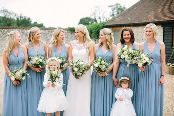 Bride and bridesmaids wearing pale blue dresses