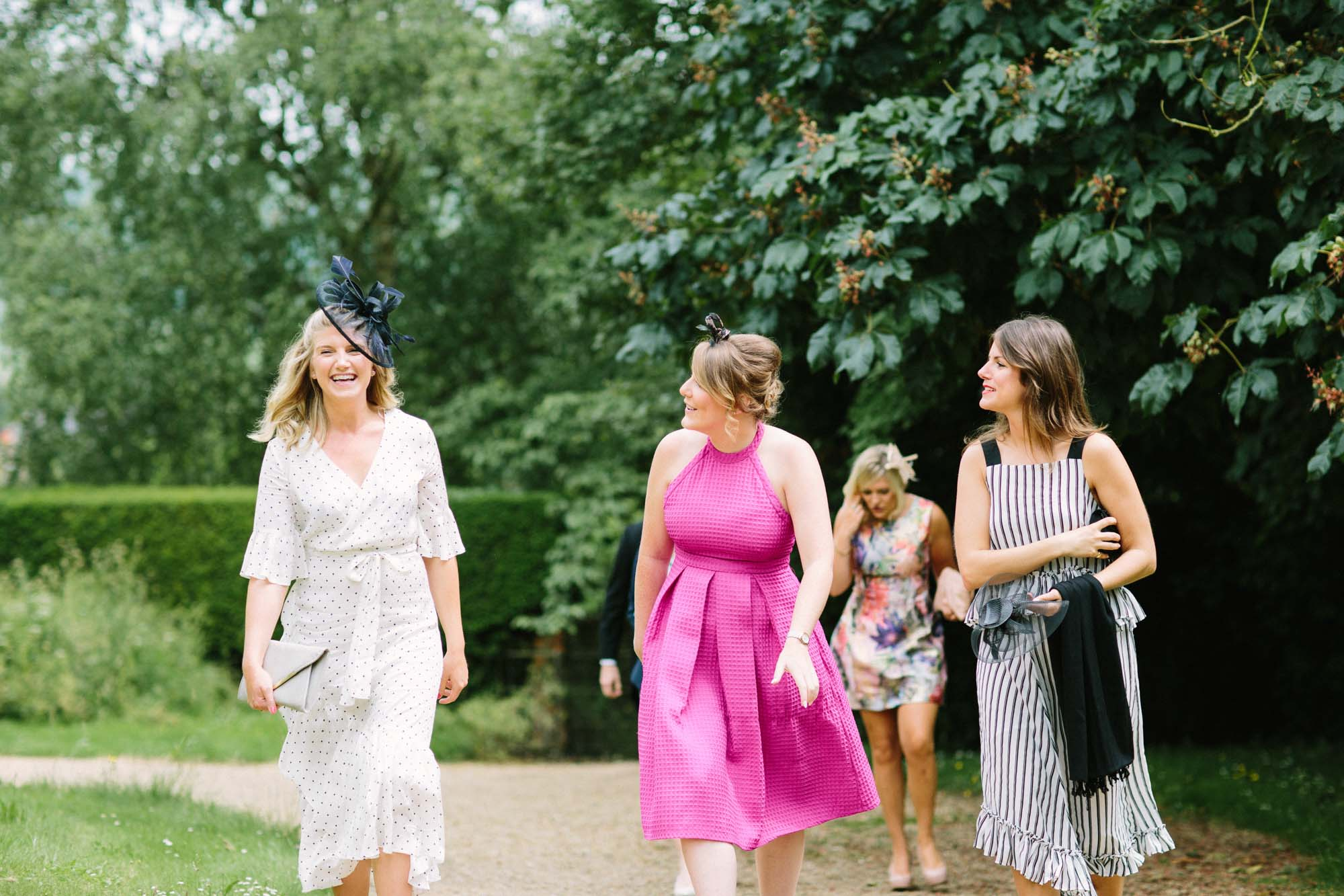 Guests arriving at church for Sussex Garden Wedding
