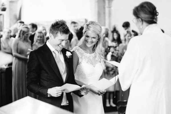 Bride and groom smiling and laughing during wedding ceremony