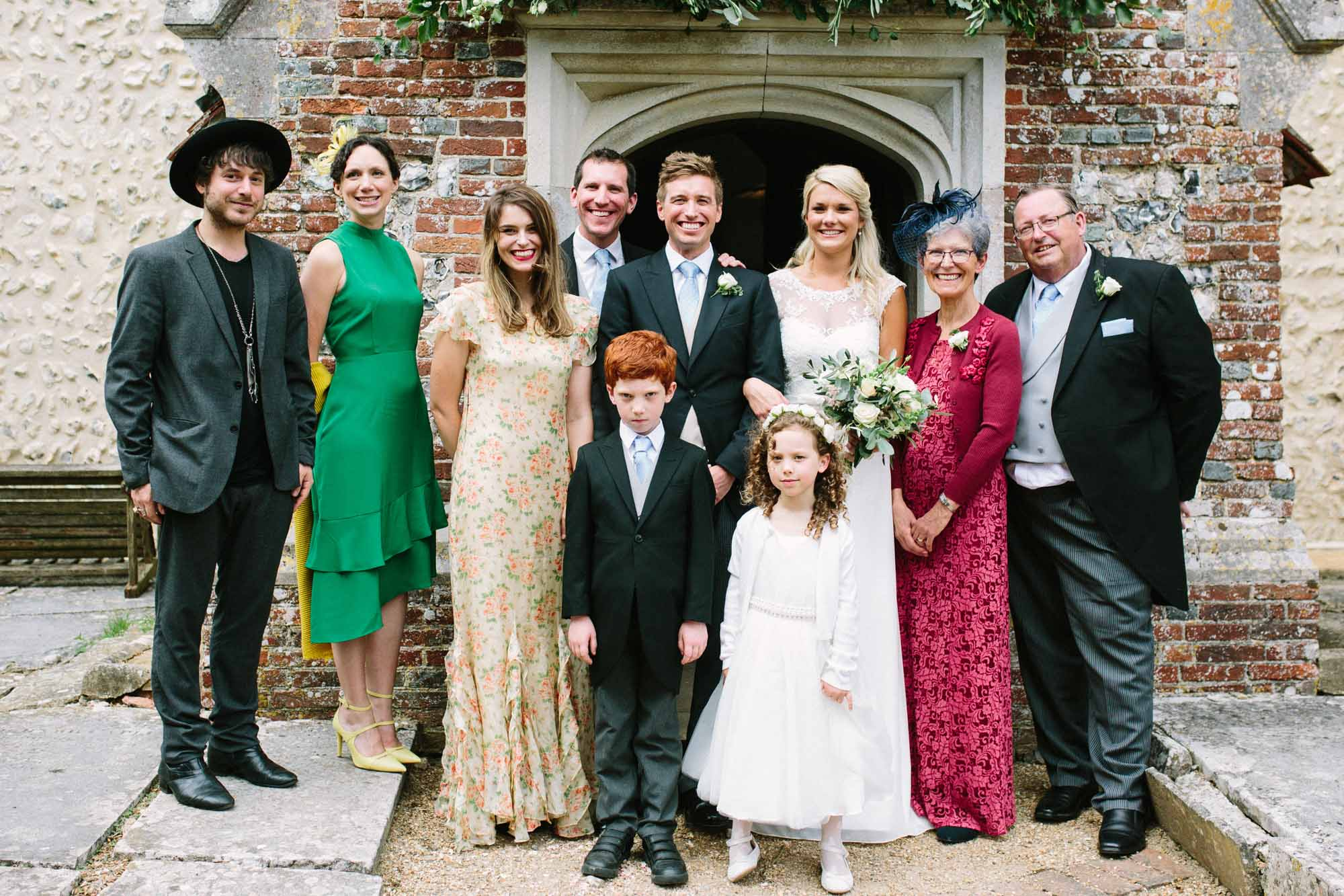 Formal family wedding photo outside church