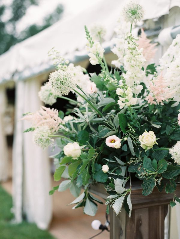 Close up photograph of flowers decorating entrance to wedding marquee at Sussex Garden Wedding