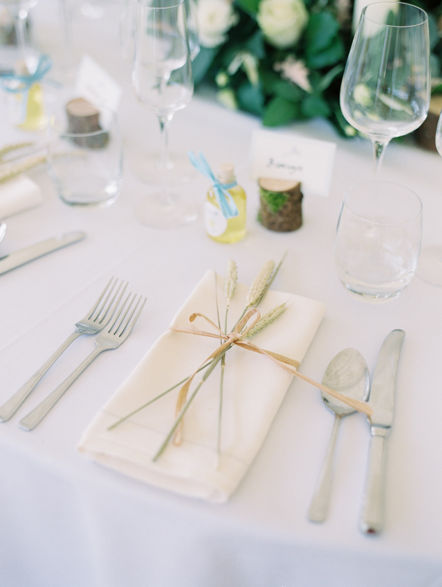 Wheat ear wedding favours on table at Sussex Garden Wedding