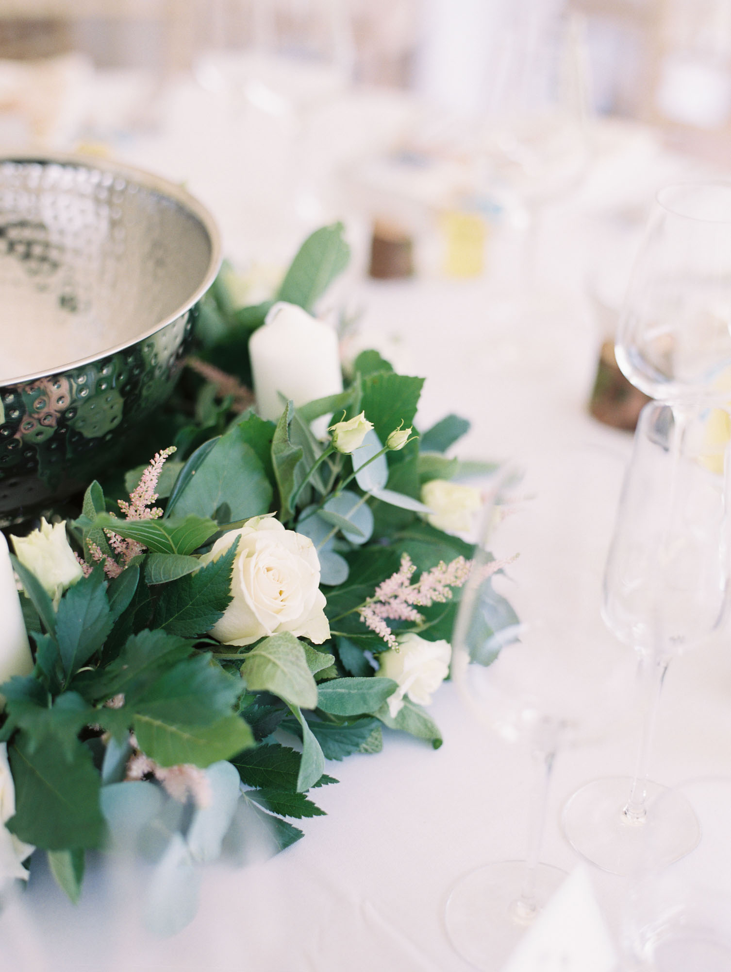 White pink and green centre pieces in marquee at Sussex Garden Wedding