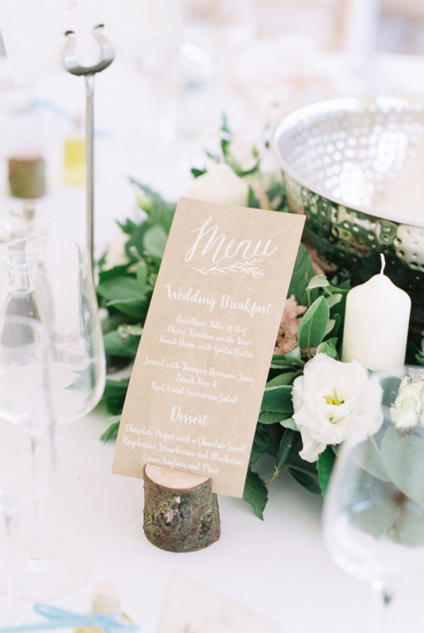 Wedding menu written with white ink on kraft paper at Sussex Garden Wedding