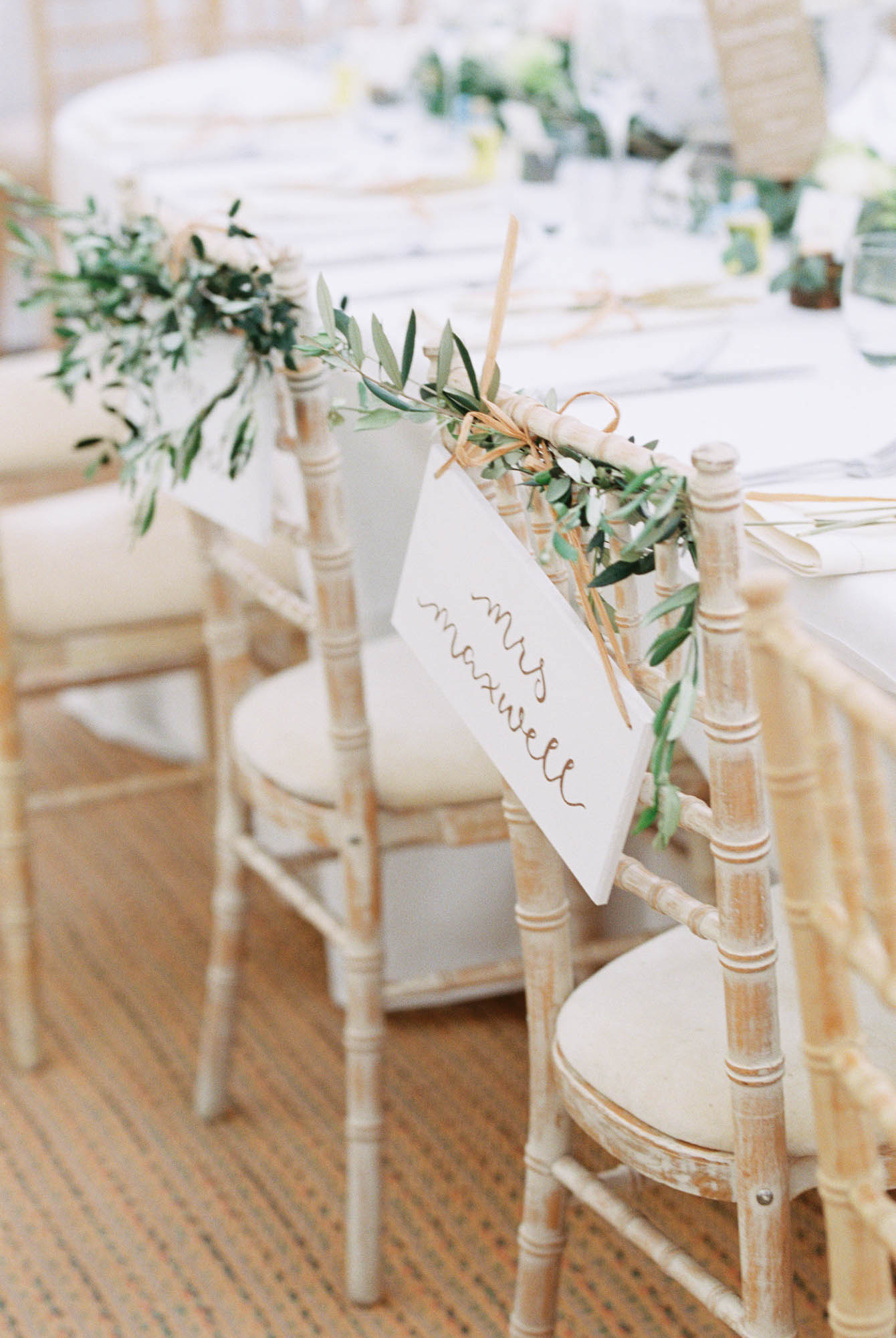 Personalised name signs on bride and groom chairs