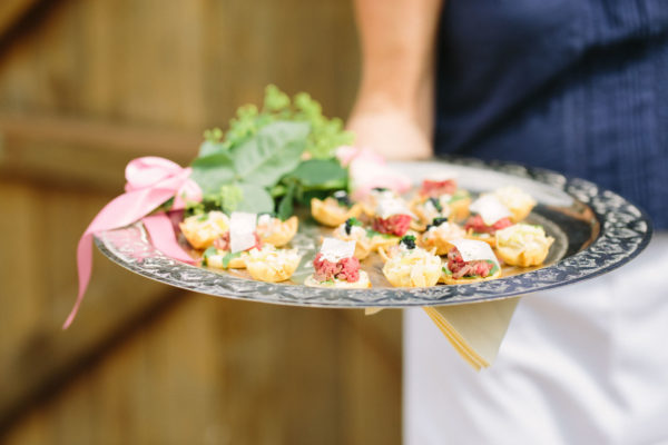 Wedding canapés being served on a silver tray