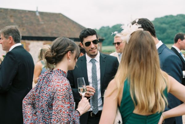 Wedding guests drinking champagne at Sussex Garden Wedding