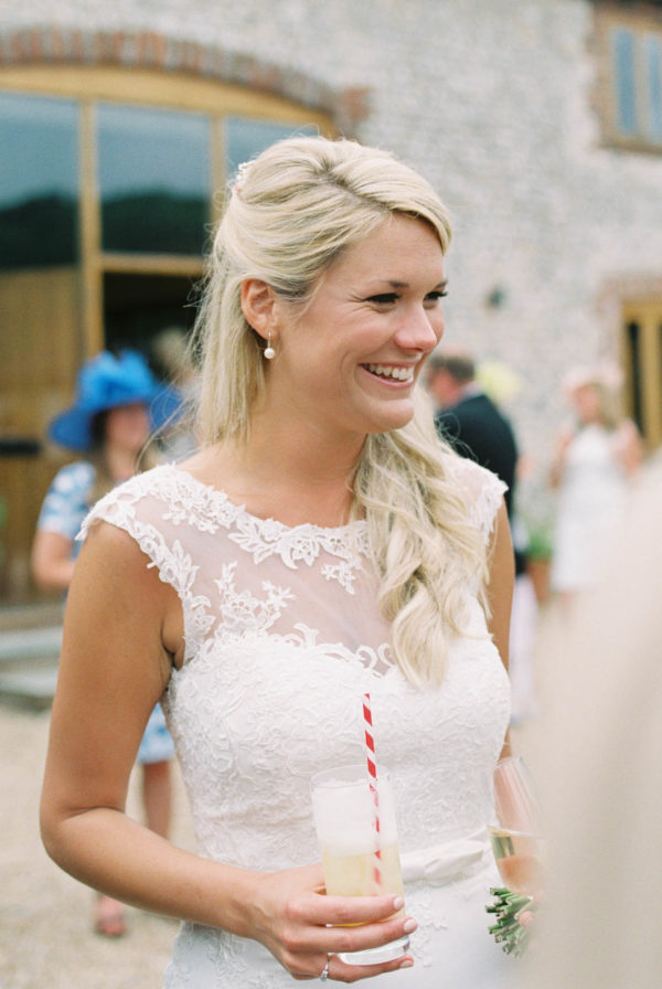 Bride smiling happily at Sussex Garden Wedding