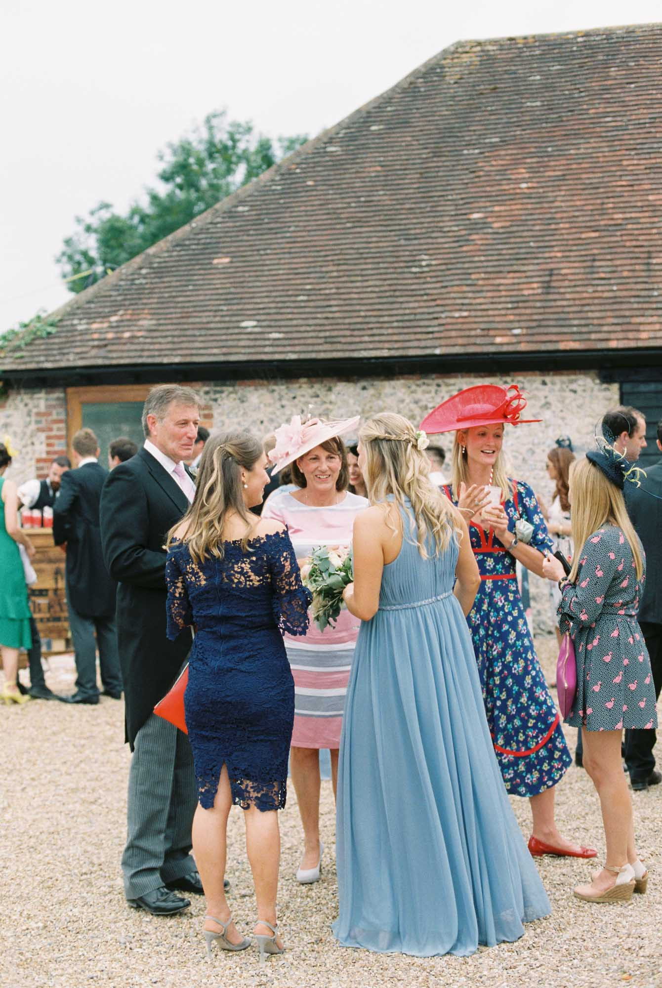 Wedding guests talking in a group at Sussex Garden Wedding