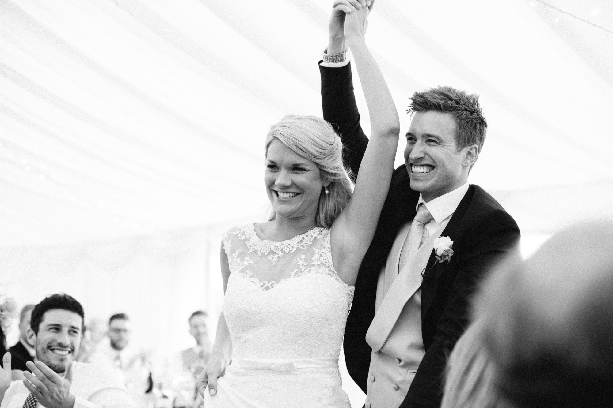 Bride and groom entering the marquee for their wedding breakfast