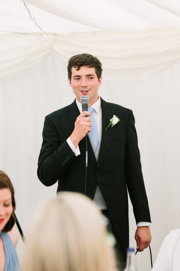 Male wedding guests announcing wedding speeches at Sussex Garden Wedding