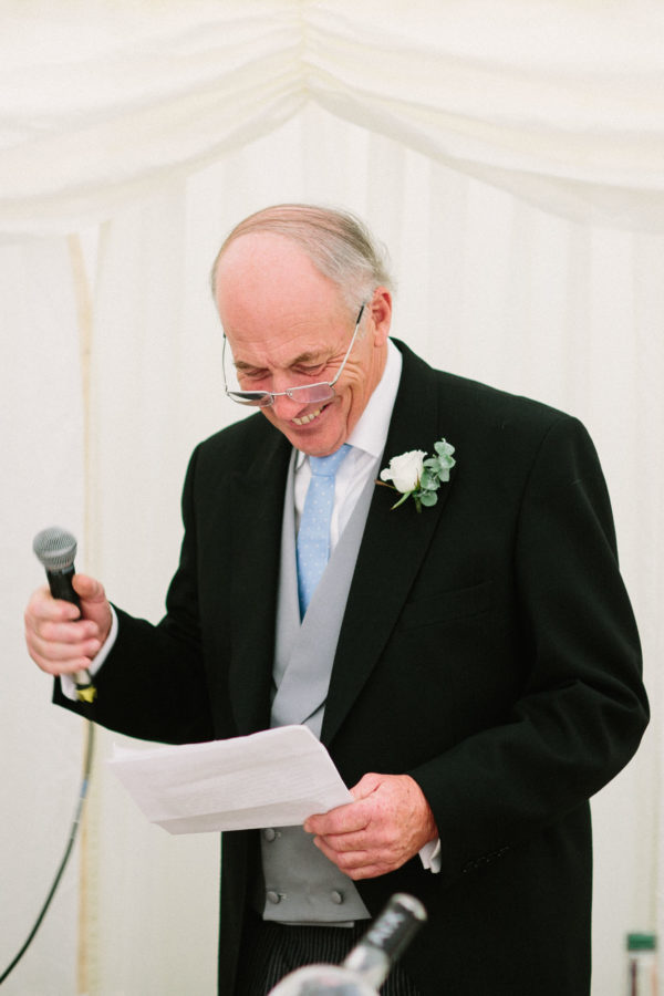 Father of the bride laughing during his speech