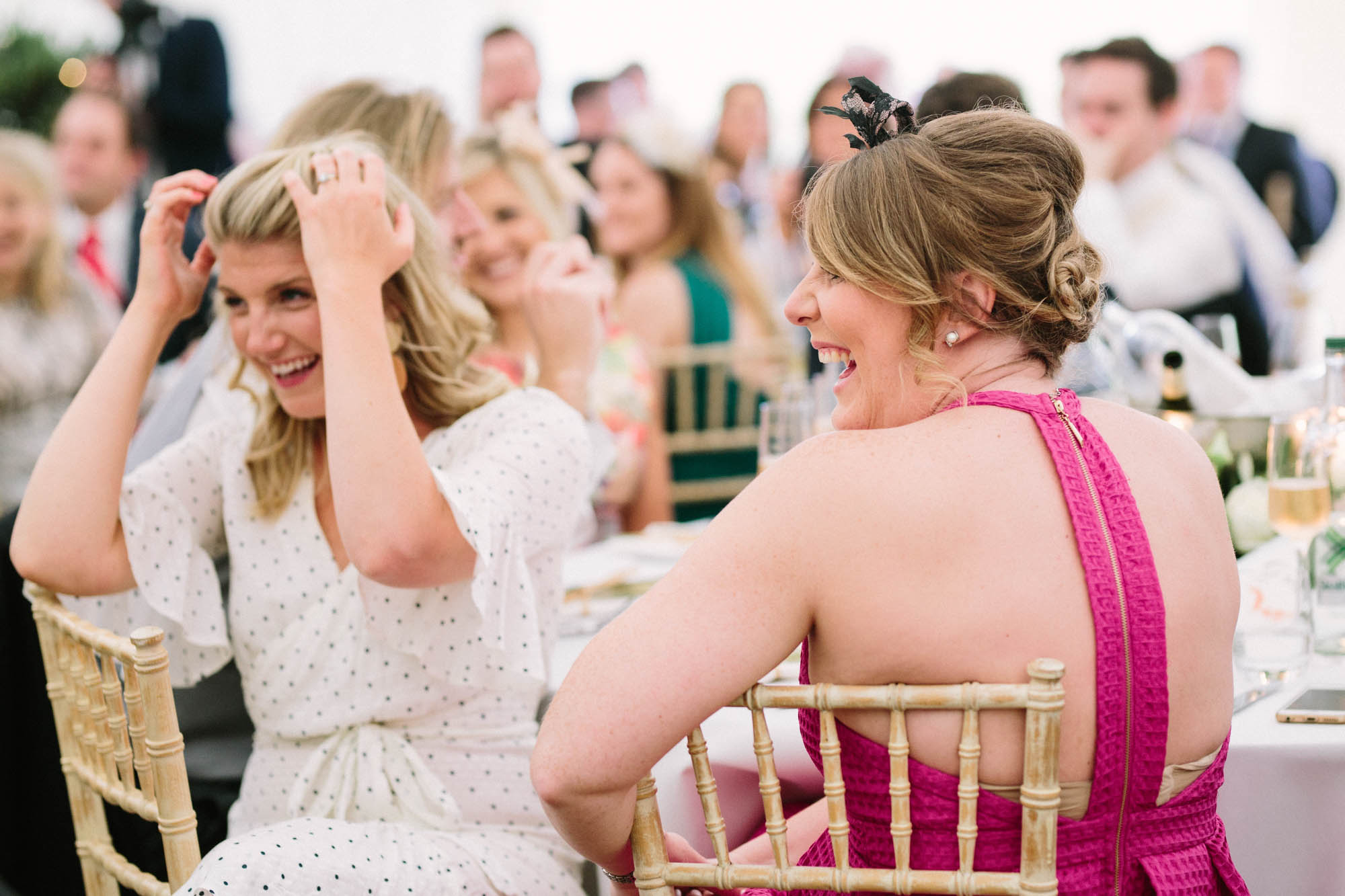 Wedding guests laughing during grooms speech at Sussex Garden Wedding