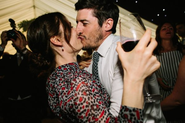 Wedding guests kissing on the dance floor