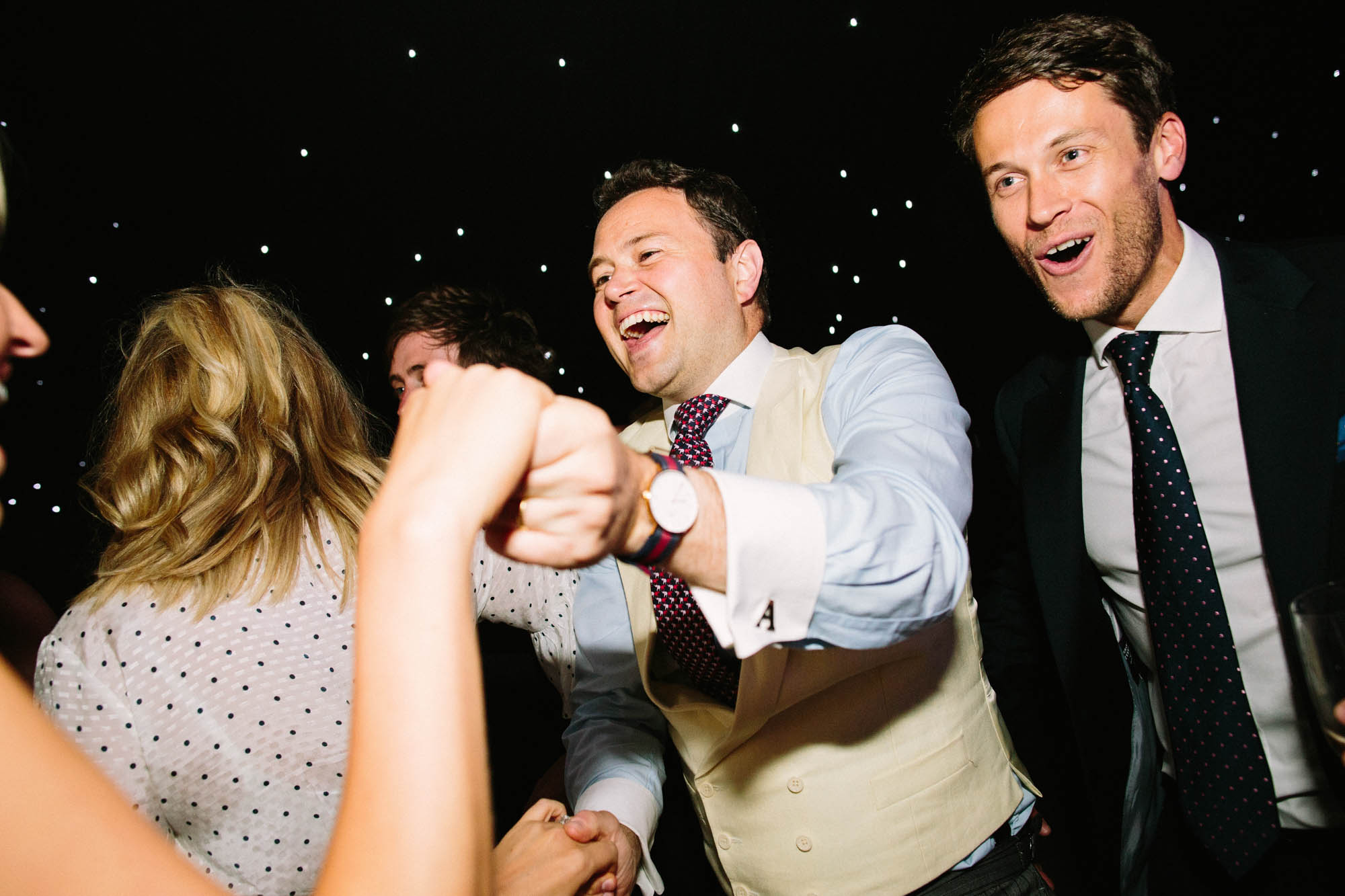 Wedding guests cheering and dancing at Sussex Garden Wedding