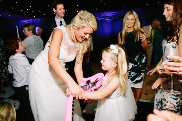 Bride dancing with flower girl on the dance floor at Sussex Garden Wedding