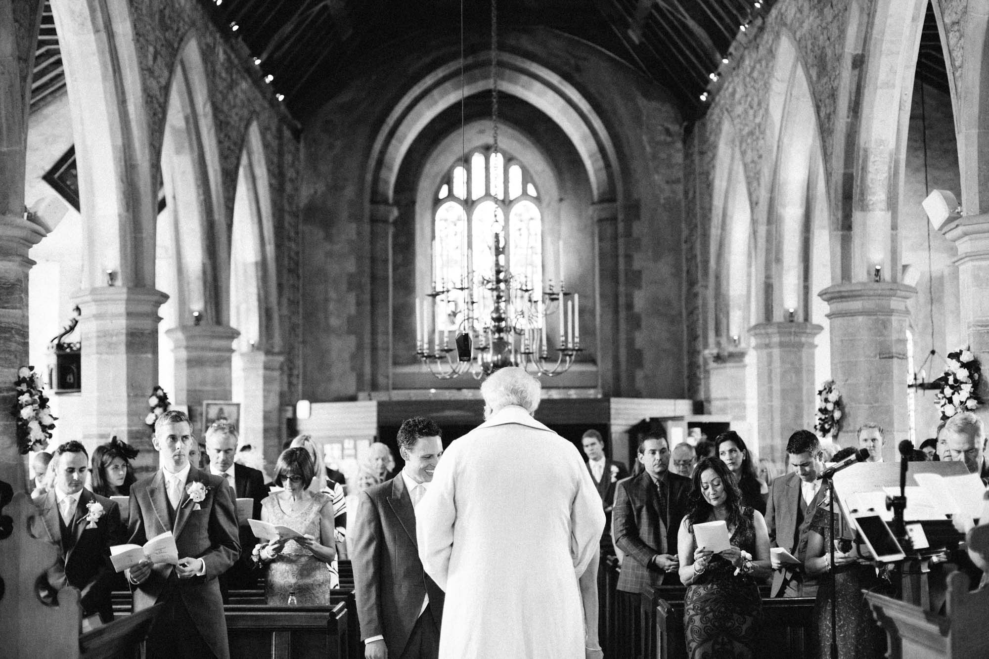 Wedding congregation during wedding service in Chiddingstone church
