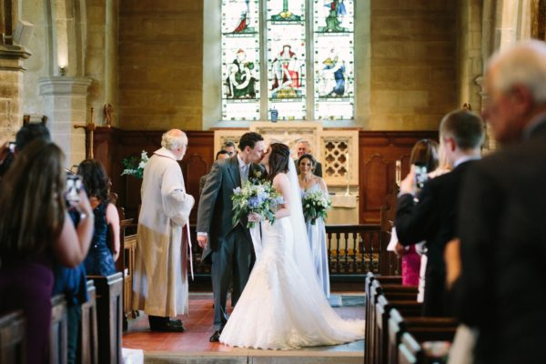 First kiss of bride and groom in Chiddingstone Church
