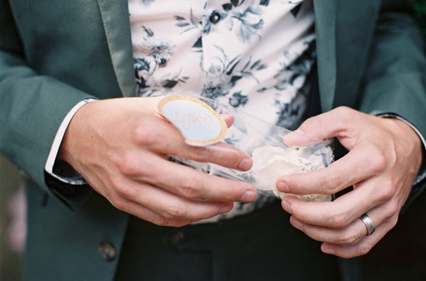 Male hands holding a packet of confetti