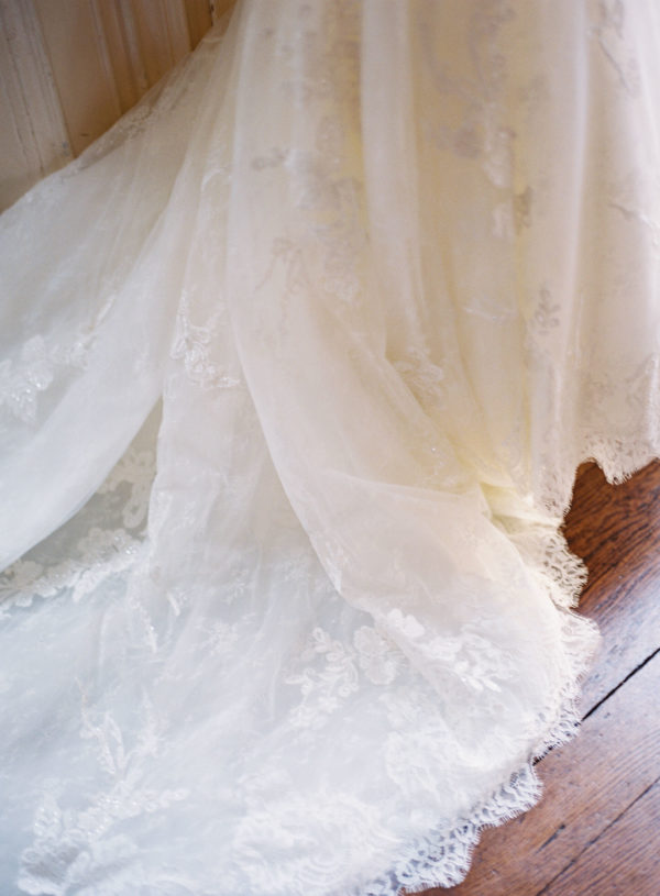 Lace detail of wedding dress at Chiddingstone Castle wedding