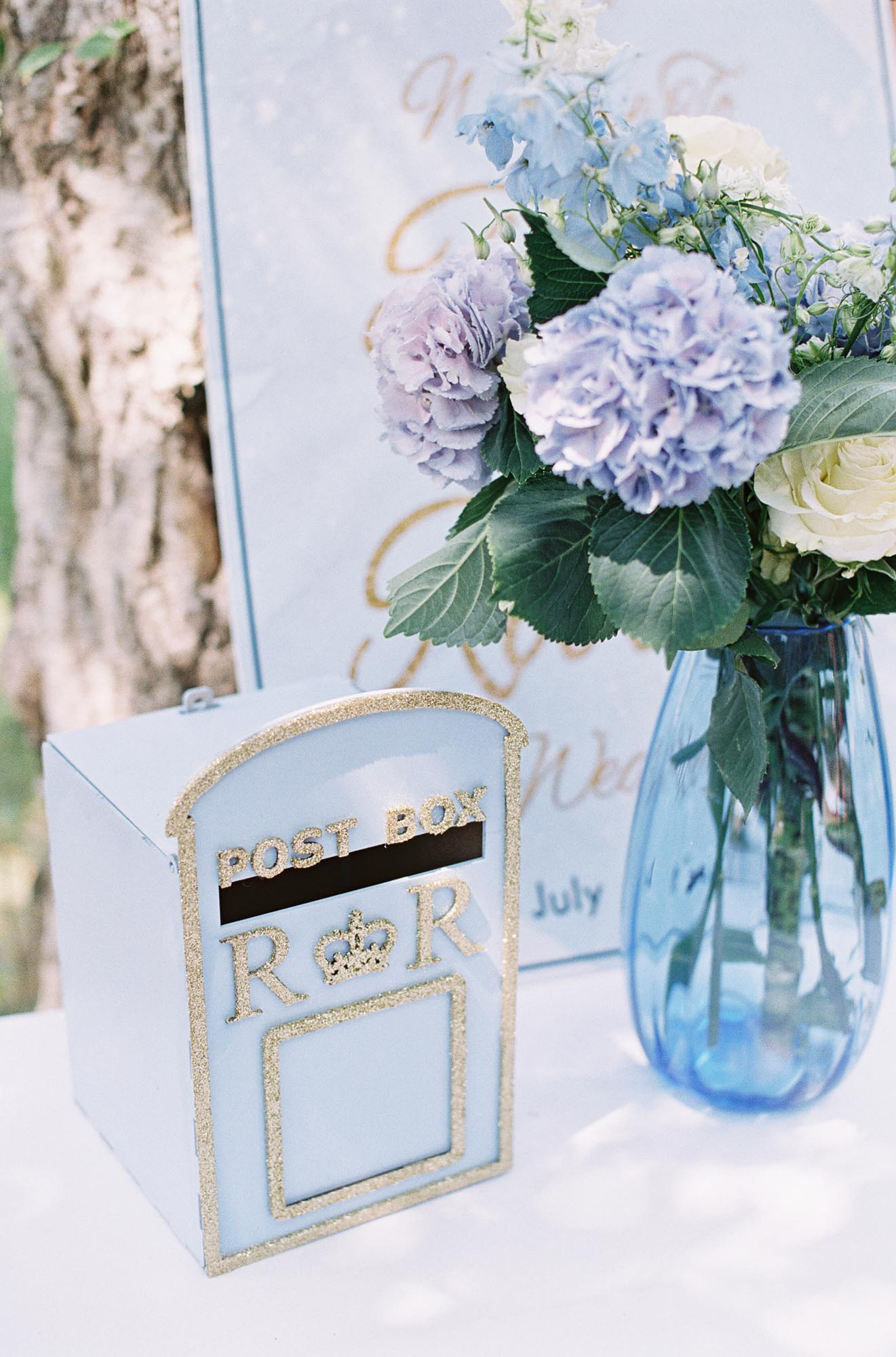Wedding card postbox and hydrangeas at Chiddingstone Castle wedding