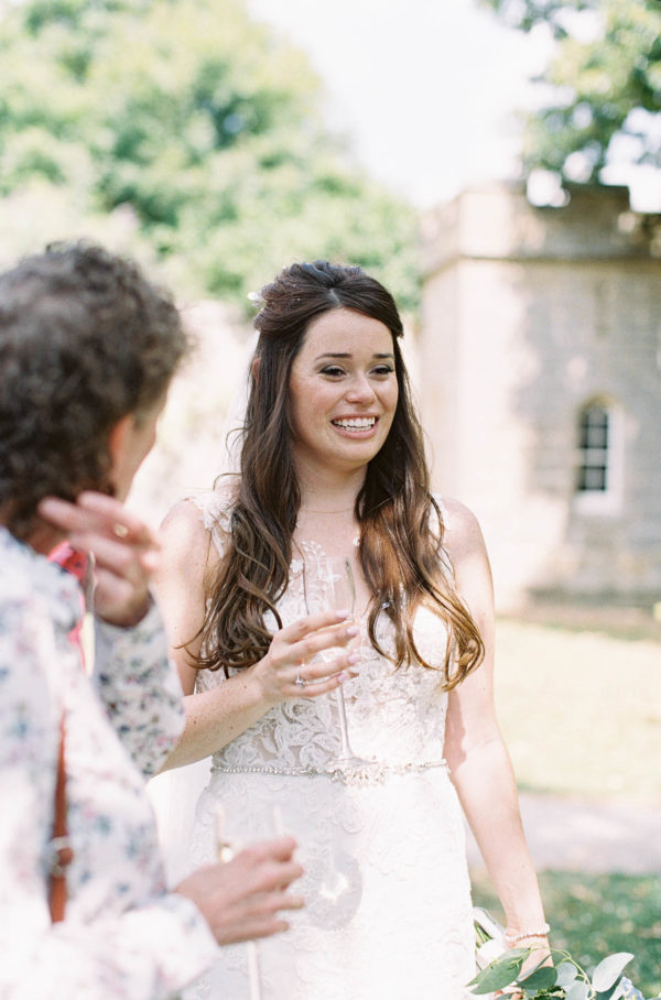 Bride smiling and talking to wedding guests