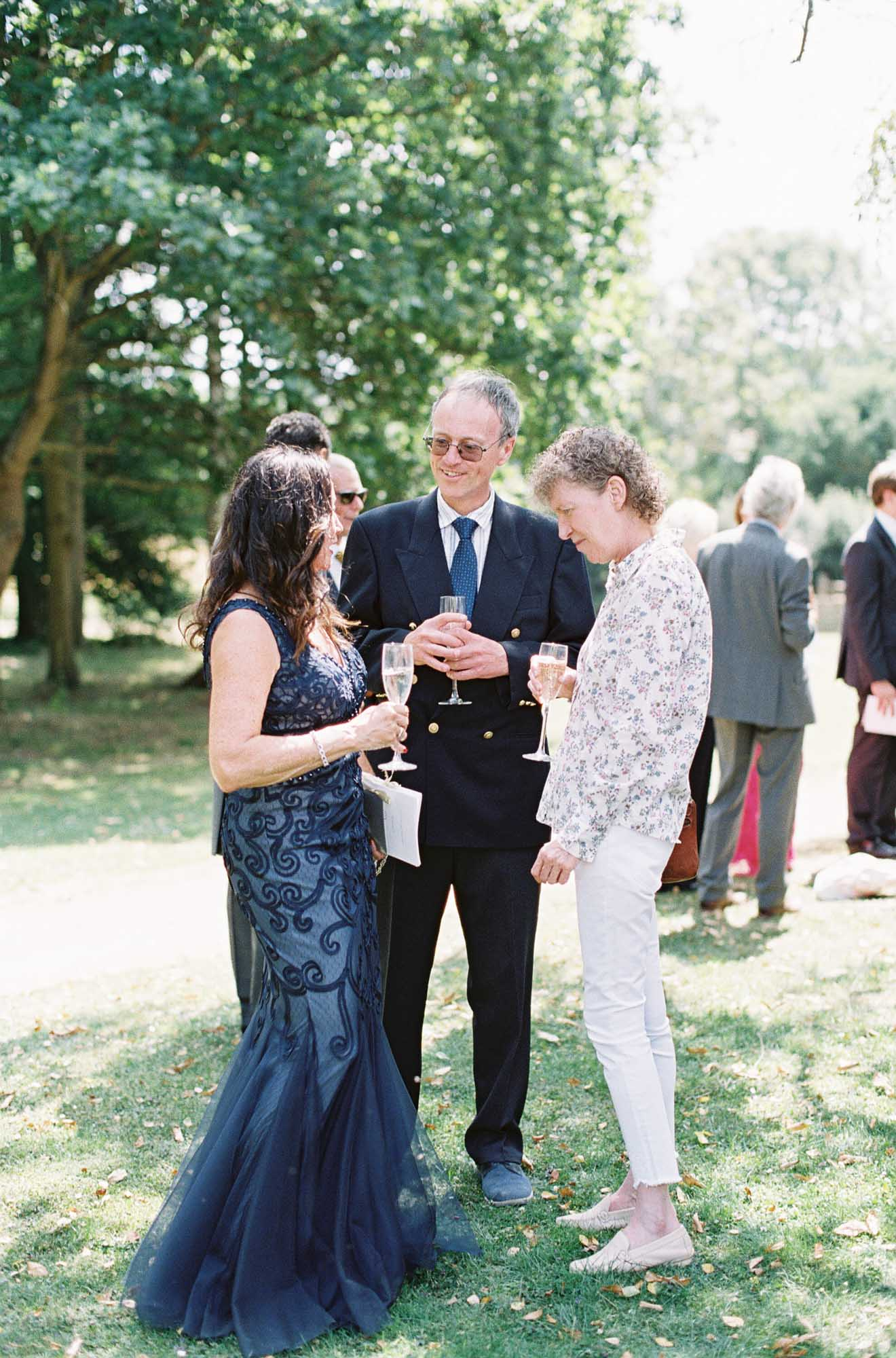 Wedding guests chatting at Chiddingstone Castle wedding
