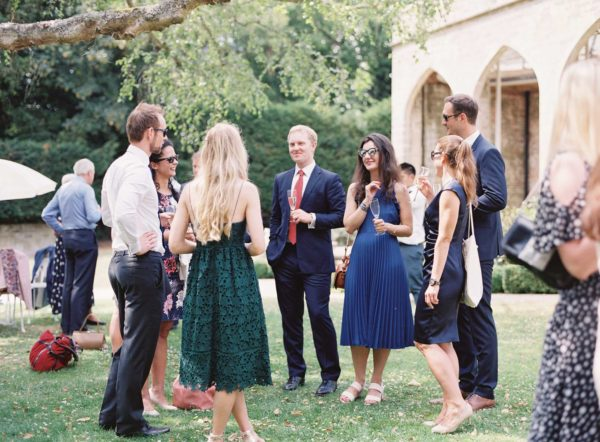 Guests mingling at Chiddingstone Castle wedding