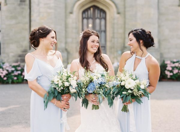 Bride smiling with bridesmaids at Chiddingstone Castle wedding