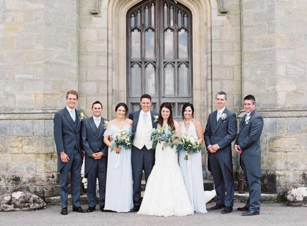 Bride and groom with bridal party outside Chiddingstone Castle