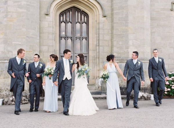 Bridal party walking and chatting at Chiddingstone Castle wedding
