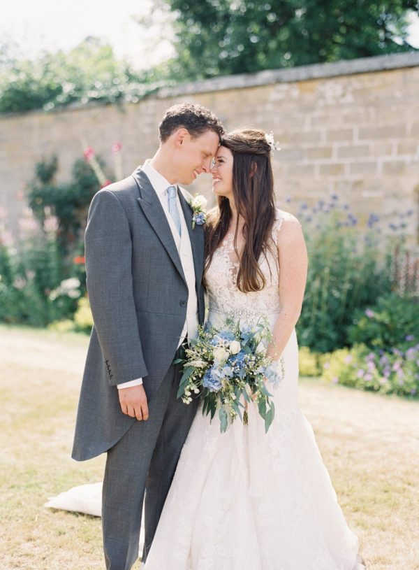 Bride and groom smiling in an intimate moment at Chiddingstone Castle wedding