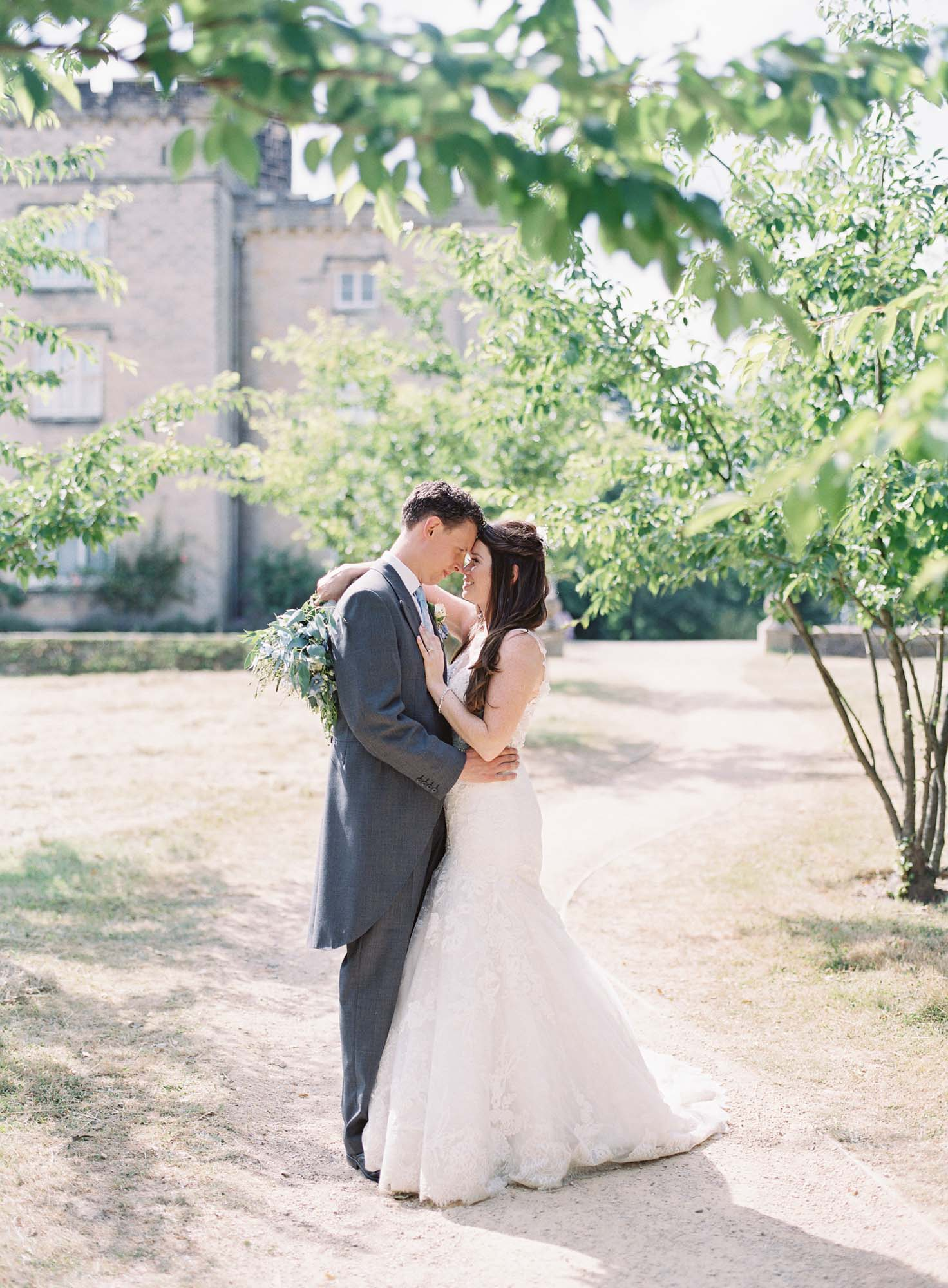 Elegant couple in the grounds of Chiddingstone Castle