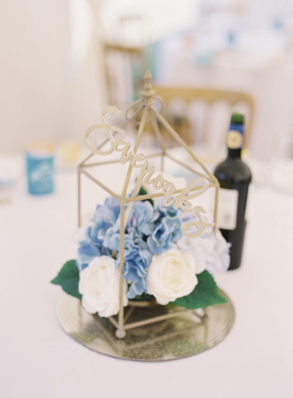 Blue and white table centre pieces in gold cages