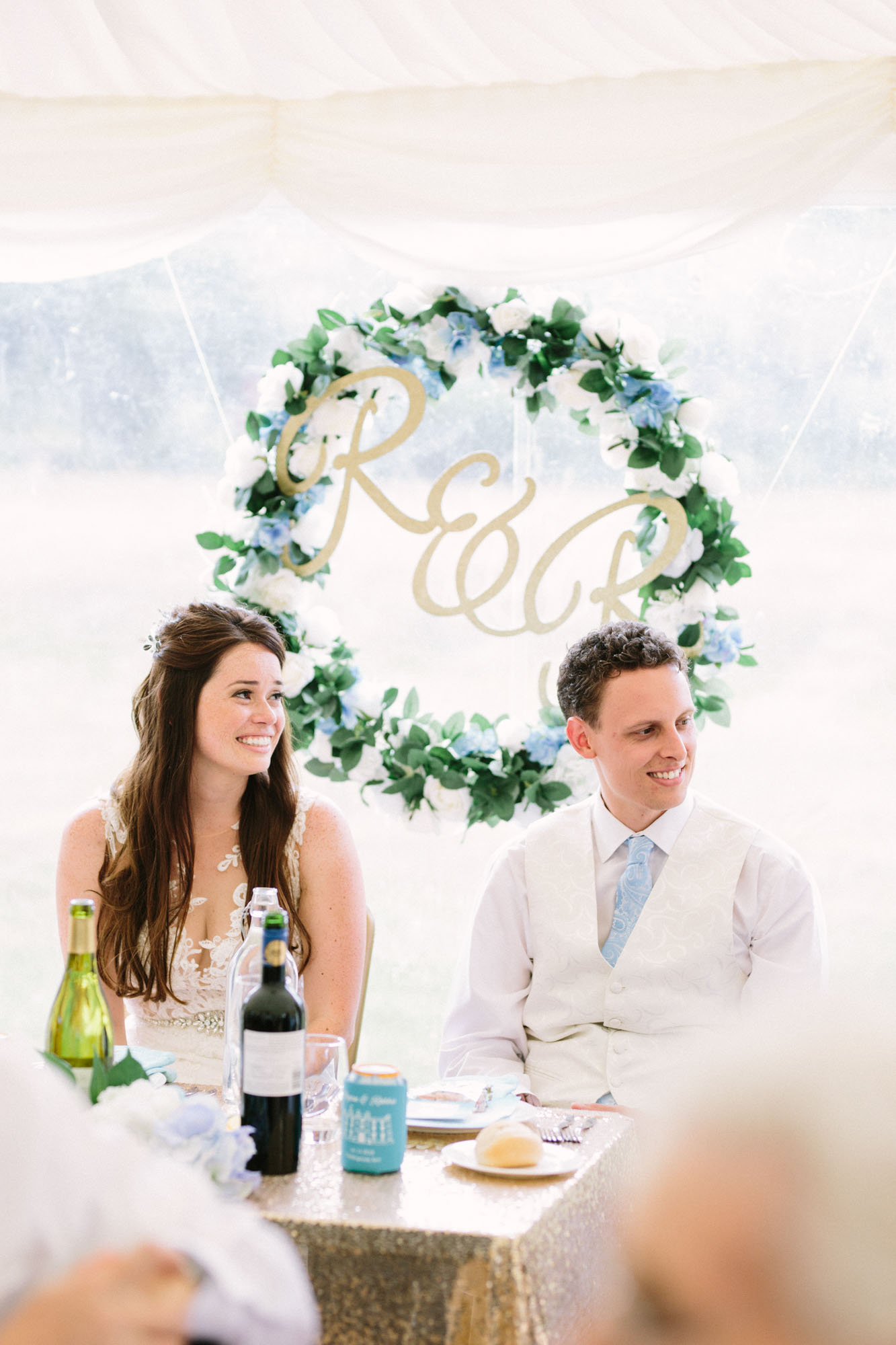 Bride and groom sitting at sweetheart table at Chiddingstone Castle wedding