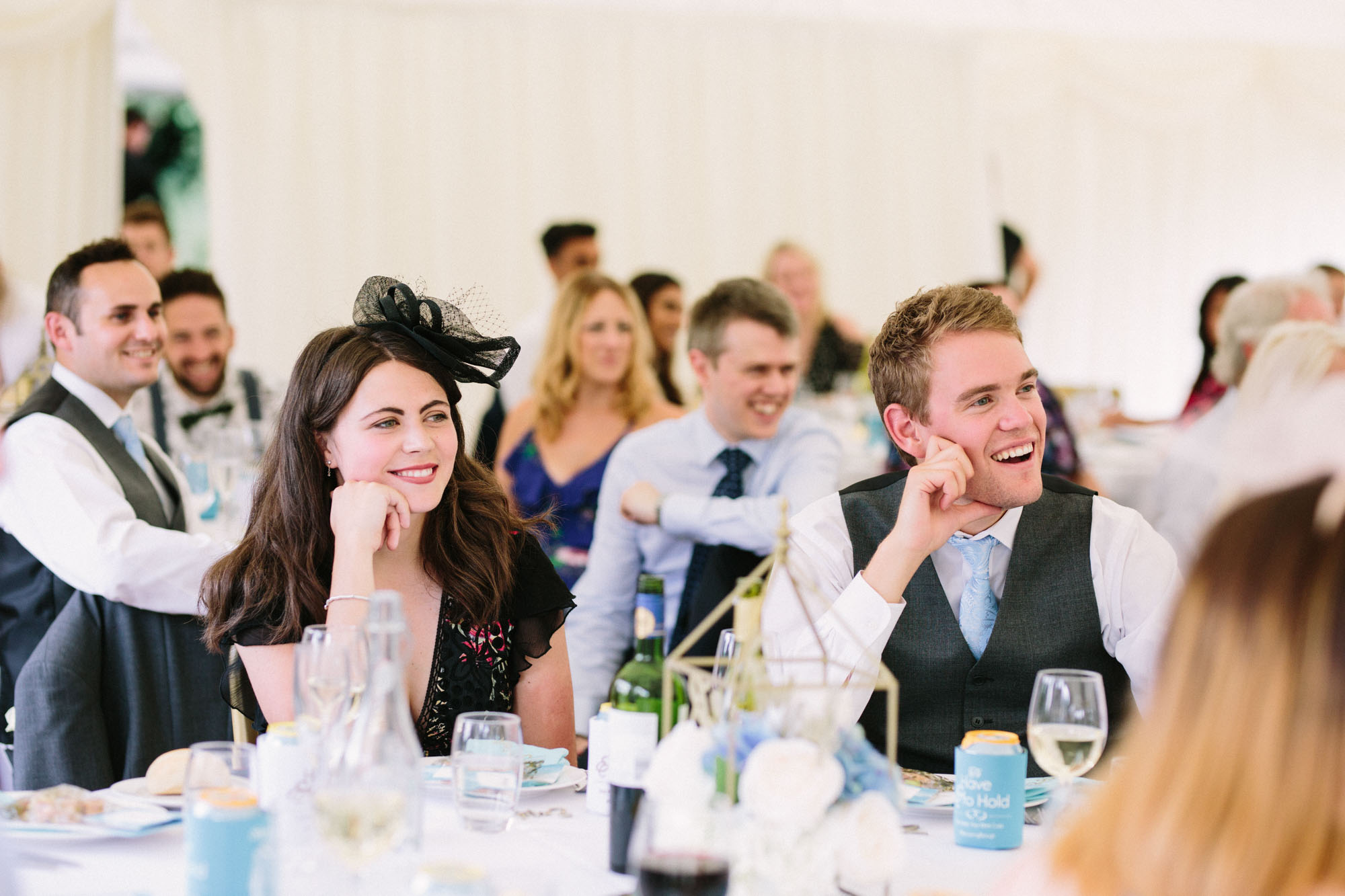 Guests laughing and enjoying speeches at Chiddingstone Castle wedding