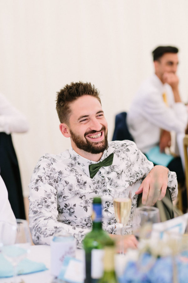 Guest laughing during father of the bride speech at Chiddingstone Castle
