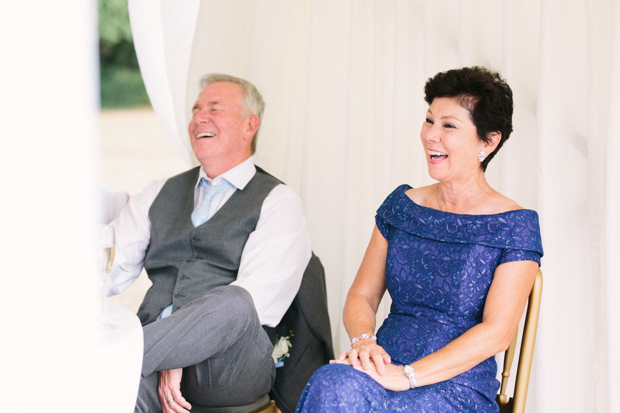 Father of the bride laughing during groom's speech