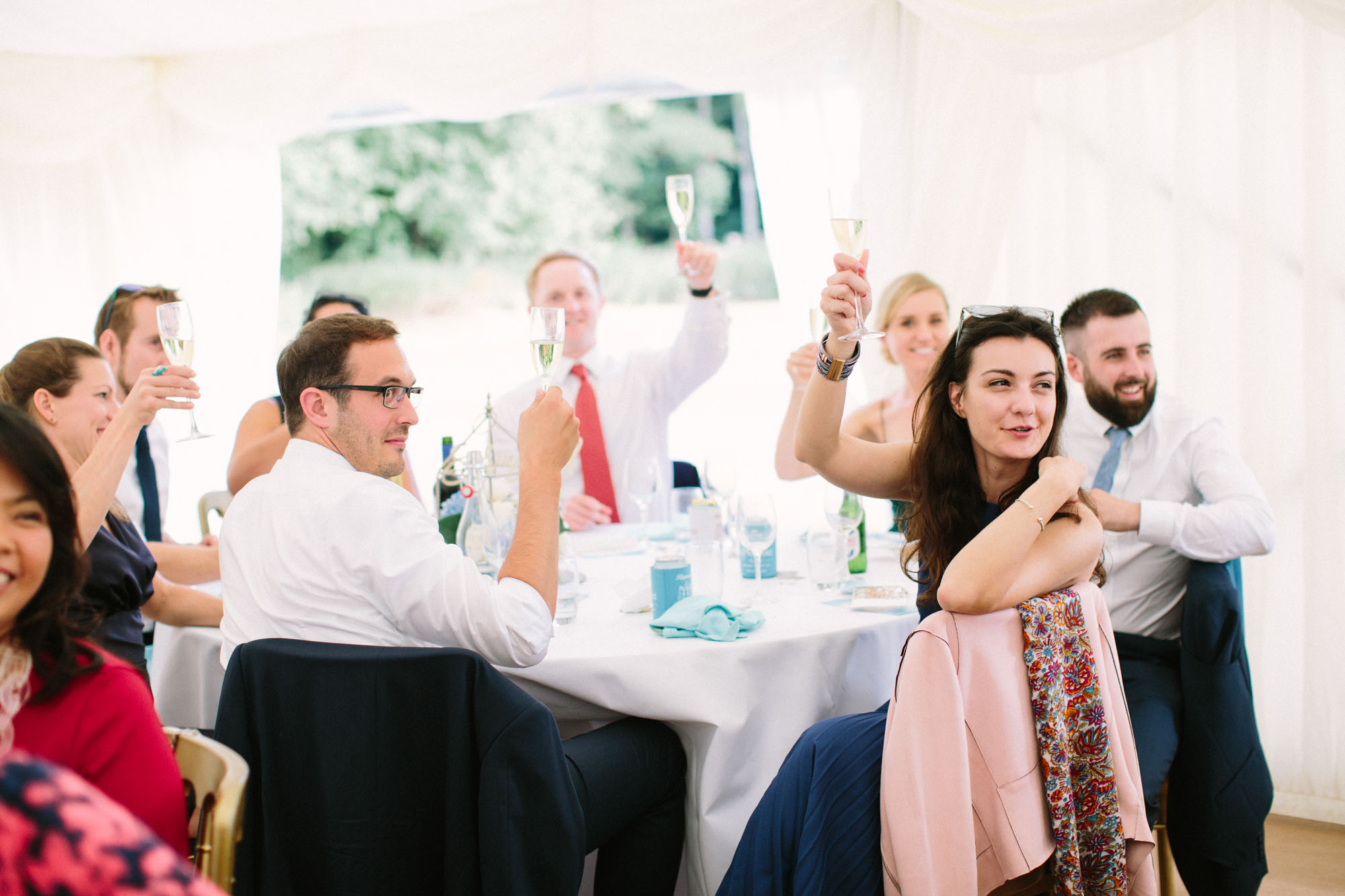 Guests toasting during speeches at Chiddingstone Castle wedding