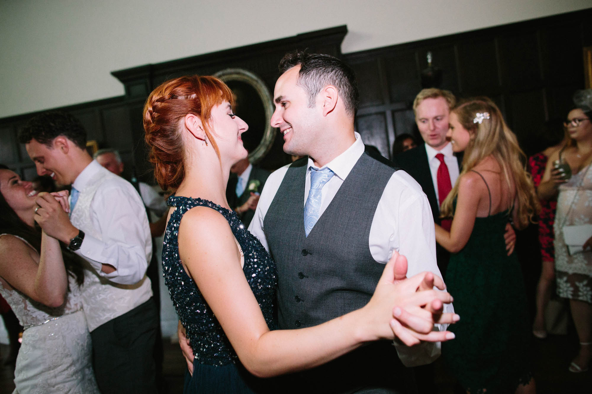 Guests smiling and dancing at the party of wedding at Chiddingstone Castle