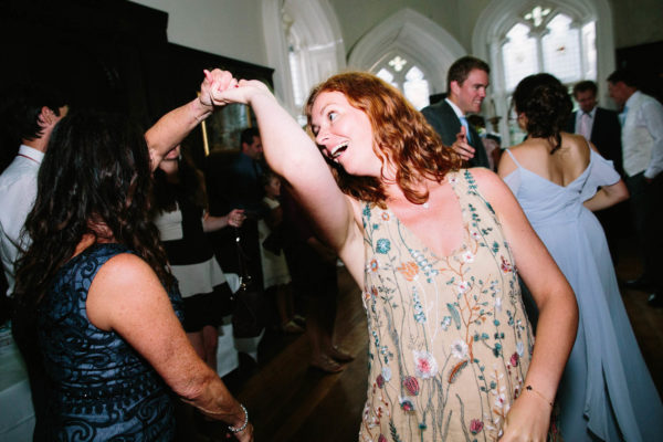Wedding guests spinning around on the dance floor at Chiddingstone Castle