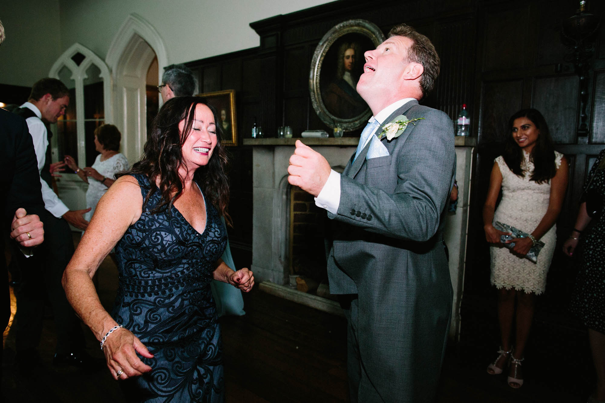 Bride's mother and father dancing in the evening in the ballroom at Chiddingstone Castle
