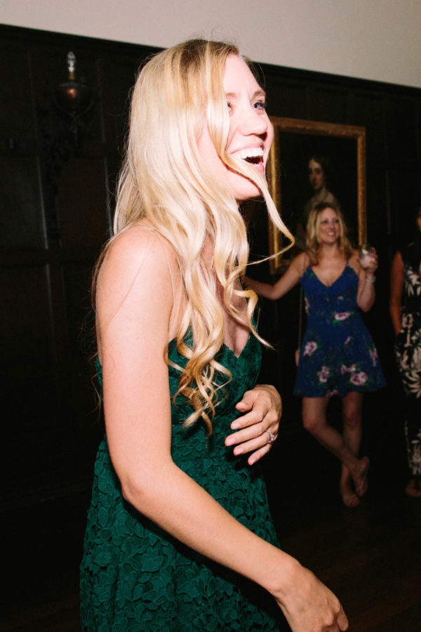 Wedding guest laughing and dancing in the evening at Chiddingstone Castle wedding