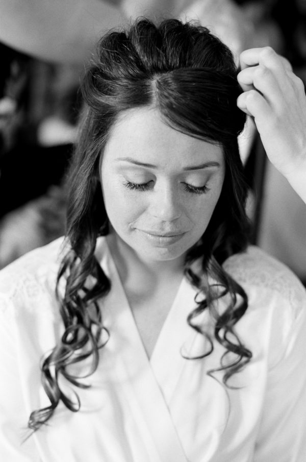 Bride having her hair done on the morning of her wedding at Chiddingstone castle